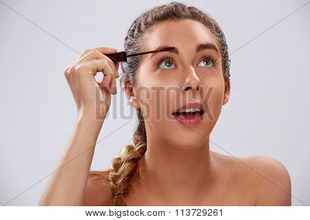 Pretty Young Woman Applying Her Makeup