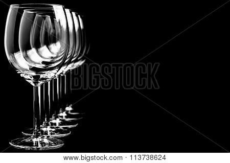 Row of empty wine glasses  on black background in horizontal format