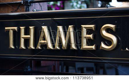 Thames  golden sign, London