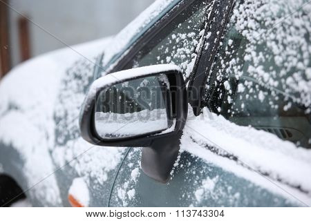 Snow Around Car Mirror