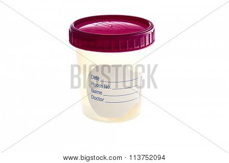 A specimen Cup with a blank label filled with liquid isolated on white with room for your text. Specimen cups are used around the world by doctors and medical professionals.