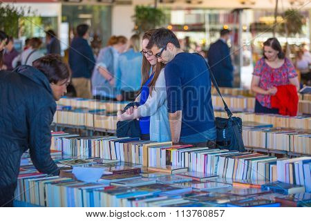 LONDON, UK - SEPTEMBER 10, 2015:  People browsing secondhand books at the Southbank Centre Book Mark