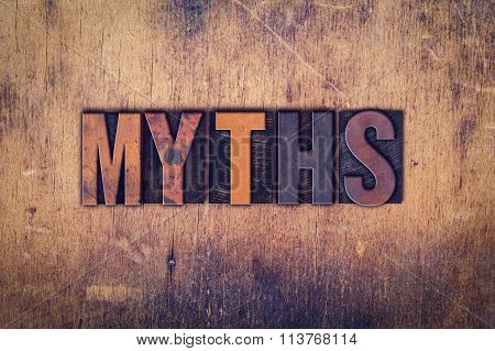 "The word ""Myths"" written in dirty vintage letterpress type on a aged wooden background. poster"