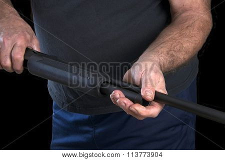 Gunsmith removing barrel of a 20 gauge pump action shotgun for cleaning