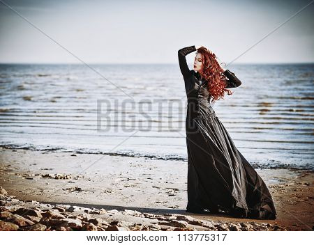Beautiful Sad Goth Girl Standing On Sea Beach