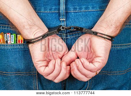 Arrested Male In Handcuffs Behind Her Back With Credit Cards In The Back Jeans Pocket