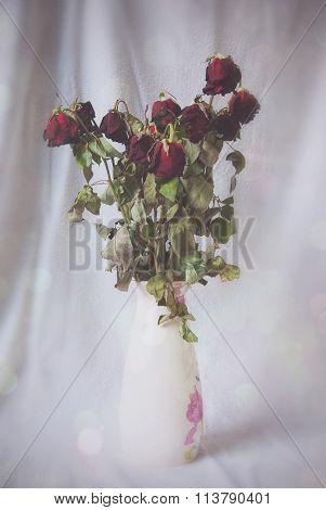Wilting Roses In Vase