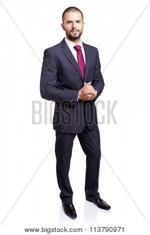 Full lenght portrait of a serious businessman, isolated on white background