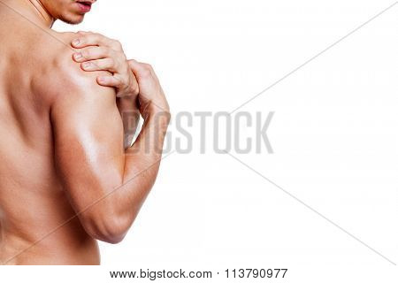Man holding his shoulder in pain, isolated on white background