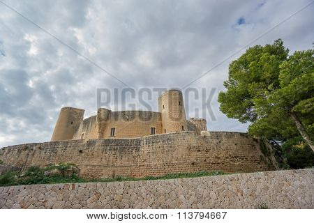 Wide angle view of Bellver Castle against cloudy sky in Majorca poster