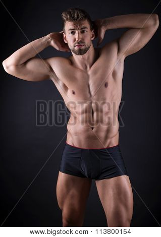 handsome young bodybuilder with toned body