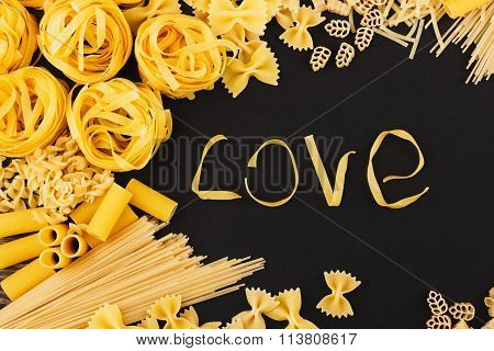 Word Love From Pasta On The Black Background
