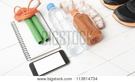 Fitness Equipment On White Wood Background
