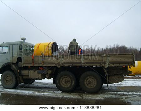 Russia, Yuzhno-Sakhalinsk - November 12, 2014: Piece of the pipeline in a truck body. Installation works.