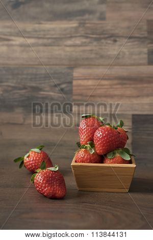 Fresh strawberries in a bamboo bowl