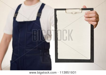 Courier In Overall With Clipboard
