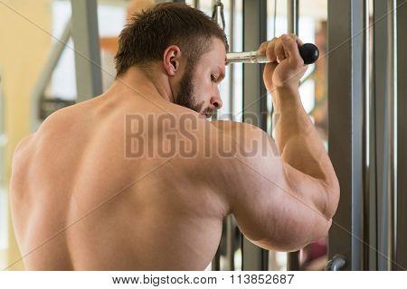 Brutal sportsman in gym.