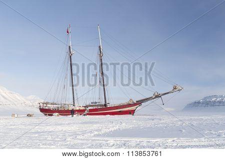 Sailboat Stranded On Sea Ice - Horizontal
