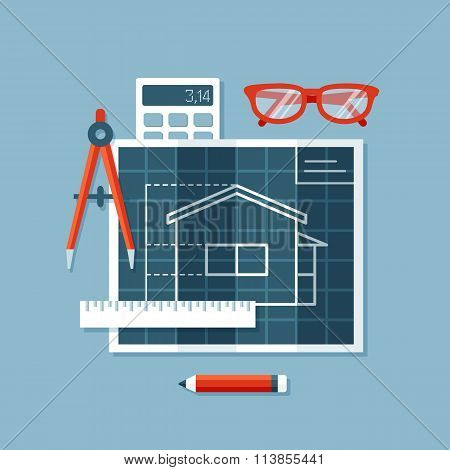Construction blueprints, Engineers Compass or divider, ruler, calculator and glasses.