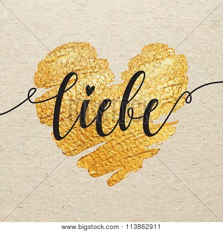 German Valentines day card. Liebe calligraphy lettering with gold paint heart on craft background. Hand drawn letters.