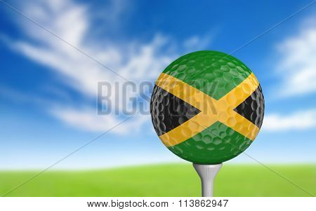 Golf ball with Jamaica flag colors sitting on a tee