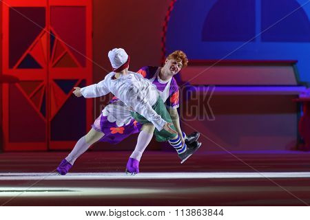 ST. PETERSBURG, RUSSIA - DECEMBER 29, 2015: Figure skaters Alexey Yagudin as Karlsson and Alexey Tikhonov as Froken Bock in a scene of the New Year show of Ilya Averbukh in Sports center Yubileyniy