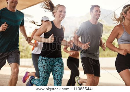 Happy Young Friends Running Together