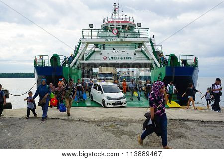 MENUMBOK, SABAH - JAN 6, 2016: Ferry with vehicles on board in the morning,carries passengers.