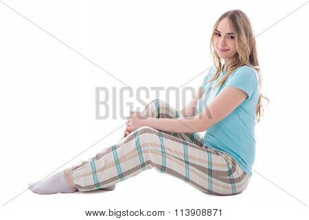 Young Beautiful Woman In Sleepwear Sitting Isolated On White