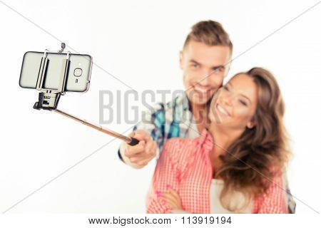Cheerful Cute Couple In Love Making Selfie Photo With Selfie Stick