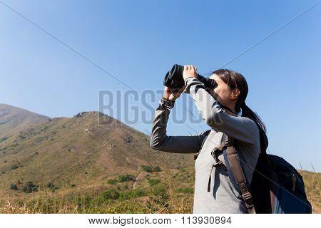 Young Woman looking though the binocular