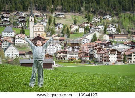 Kid enjoying Swiss coutryside in idyllic Alps