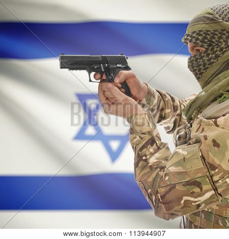 Male With Gun In Hand And National Flag On Background - Israel