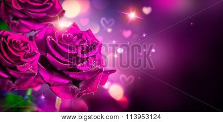 Roses and Hearts background. Valentine or Wedding Card design. Beautiful violet roses bouquet over purple blurred background. Flowers background. St. Valentine's Day roses art design