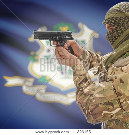 Male With Gun In Hand And Flag On Background - Connecticut