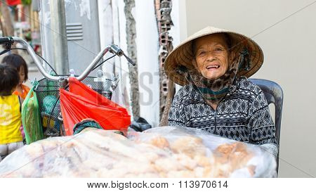 HO CHI MINH CITY, VIETNAM - JAN 10, 2015: Unidentified local woman street vendor. By the end of 2014, the city's GDP grew 9.5%, with GDP per capita reaching $5100.