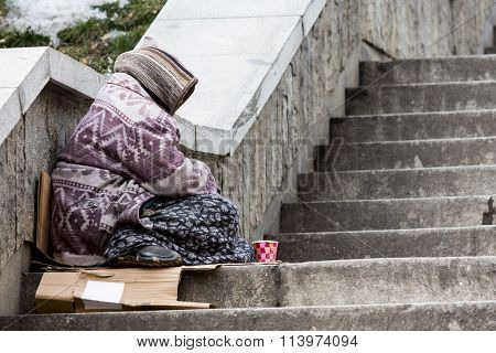 Homeless Gypsy Woman Begging For Money Alone