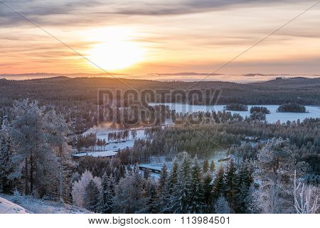 Sunset Over Frosty Winter Forest