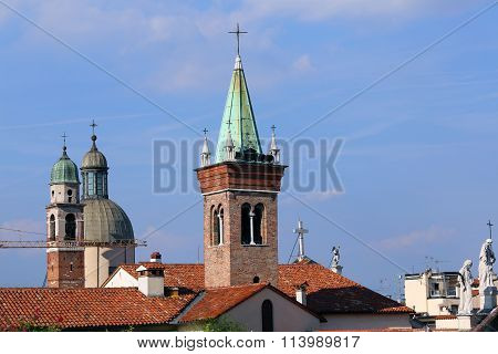 Bell Towers And Roofs And Statue Of The Vicenza City In Italy