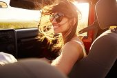 Woman Passenger On Road Trip In Convertible Car poster