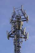 mobile comunications antenna for 2g (gsm) and 3g (umts/wcdma) handsets in europe. antennas for 3 carriers share the same mast. poster