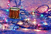 an artistic hsot of a decorative toy drum on a colorful background poster