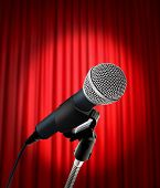 Umage of microphone and red curtain with spot light poster