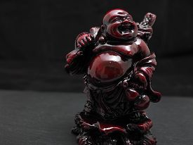 Laughing red buddha