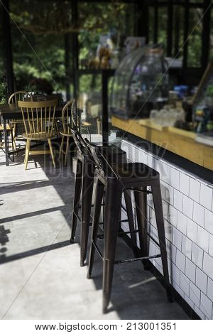 Village cafe with metal counter bar chairs stock photo