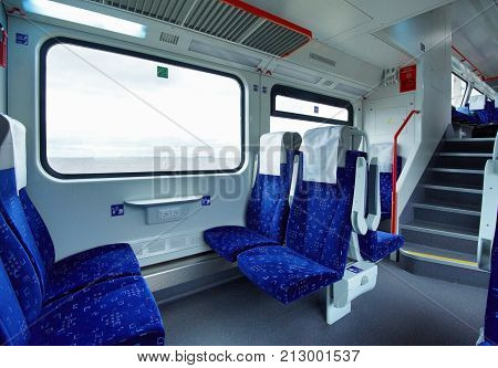 Emtpy interior of the intercity double decker train of comfort class.