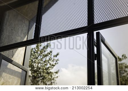 Modern loft window with natural outside view stock photo