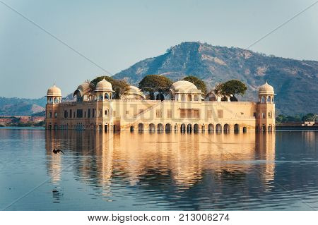 Jal Mahal Jaipur Rajasthan India. Palace on the water of Man Sagar Lake with mountain on the background. Famous travel and tourist attraction