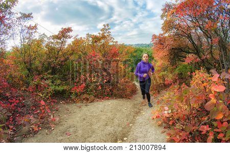 Woman  Runs On The Colorful Red Autumnal Forest Hill