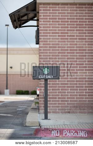 Miami USA - October 3 2017: Starbucks exterior logo and sign Exit only. Starbucks is the biggest chain of coffeehouses.